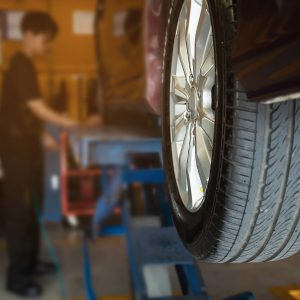 Technician is inflate car tire - car maintenance service transportation safety concept